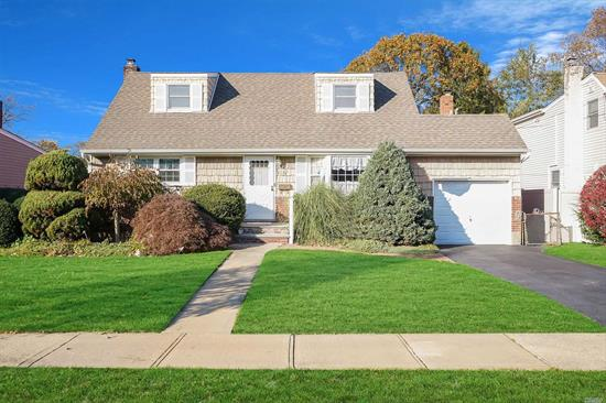 Home Sweet Home. Come check out this charming cape located on a quite desirable block located in East Meadow School District. Beautifully kept landscaping with in-ground pool brand new liner & In-ground sprinklers thought the yard. Possible Mother Daughter with permits -Taxes with star $10, 134.