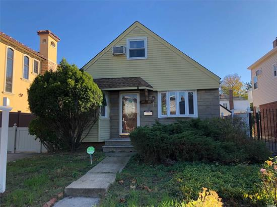 Opportunity Knocks! Prime Prime Whitestone Location! This Home is Situated on a Quiet Tree Lined Street on a Malba Gardens Block! Build Your Dream House for a Great Price!