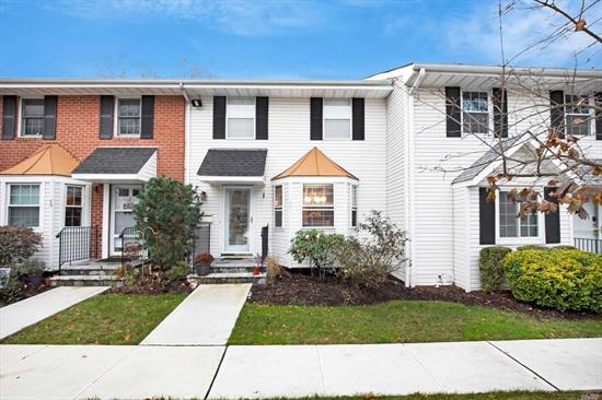 Beautiful updated 2 BR Unit with granite kitchen and gorgeous fireplace in the living room. 2 large bedrooms upstairs, one with full bath. Lots of closets. Finished basement with lots of room. New heating system.