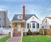Beautifully updated 4 BR, 2.5 bath, cape home with finished basement. beautiful backyard and 2 car garage. Mid block location, 10 min walk to LIRR station.