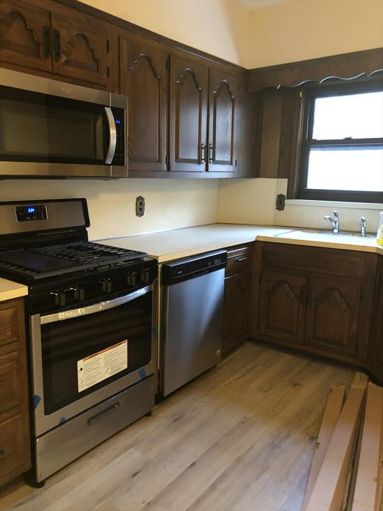 arge open 2 bedroom plus one bath with eat in kitchen, hardwood floors and lots of windows in a private home. Conveniently located just minutes to the light rail and bus transportation, Italian Deli and restaurants.  $2600 includes heat and hot water.  No pets allowed.