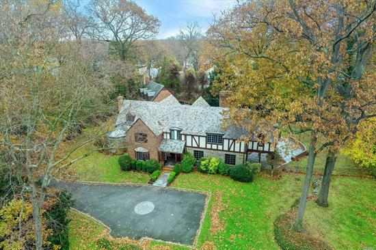 Entertaining flows from the grand principal rooms to the bluestone patio overlooking spacious yard. Updated & renovated, this designer-style home on 1 acre features a formal LR w/fp, FDR, library w/fp, sunlit den, gourmet EIK & conservatory on main flr. Upstairs is a luxurious master suite w/bath & balcony, 4 addtl. BRS, 3 full baths + guest suite w/bth. A gym, 2nd fam Rm & laundry on lower level.
