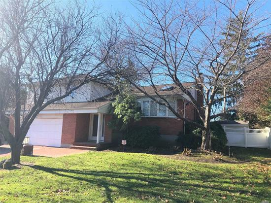 Expanded split in perfect location. Move in condition. Beautiful wood floors, updated baths, newly finished basement, lovely yard. Expanded dining room and kitchen with granite and SS appliances.