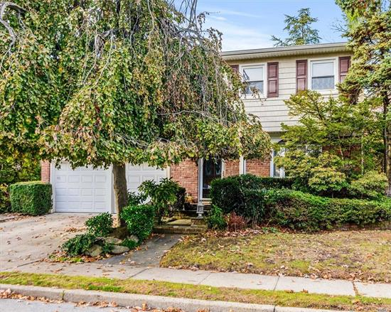 Location! Location! Location! Spacious Colonial in the Heart of Cedarhurst Features 4/5 Bedrooms, 2.5 Baths, Finished Basement, Main Level Den with Fireplace and Skylight, Granite EIK, CAC, Gas Heat, Alarm, Hardwood Floors, Sandy Dry! Near All