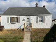 Charming Cape Located in the heart of elmont. valley stream schools. 4 bed, 2 bath with nice yard. just in time for the holidays