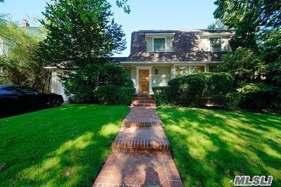 4BR Colonial with Finished Attic. 80 by 100 lot. Built in 1923 with alterations in the 1980s. Architect F Willard Bowman. Freestanding Colonial Revival with Attached Garage. Double gambrel roof with flared eaves, shed dormers, lunette in gambrel end. Alterations in 1980's include garage wing, replacement windows and door, and replacement siding.