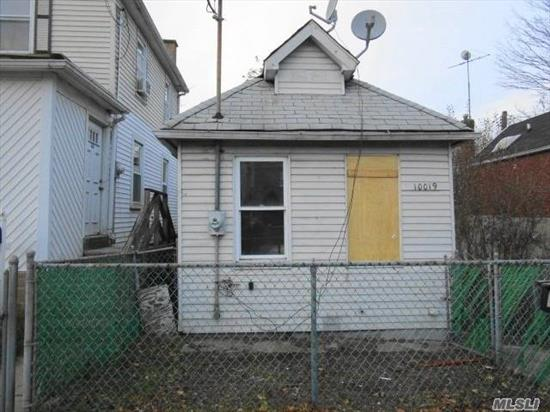 Great Opportunity - One family detached three room bungalow, conveniently located within walking distance to Rockaway Parkway shopping, schools, and bus transportation, L train station is 1 mile away. The property requires repairs.