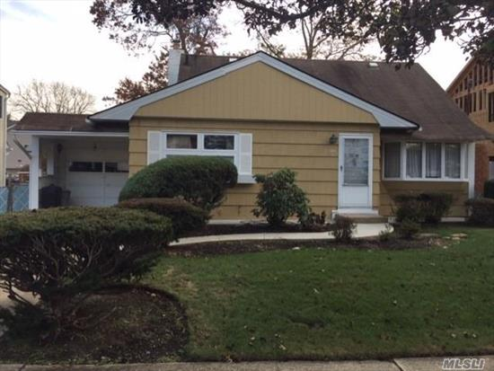 Great Home and Location!!! Nestled in the heart of Massapequa Park this Spacious Home features: Hardwood Floors, Anderson Windows, 4 Bedrooms, 1 Bath, Large Living Room, Full Finished Basement & 1 Car Garage. Close to shopping and restaurants. Call today!
