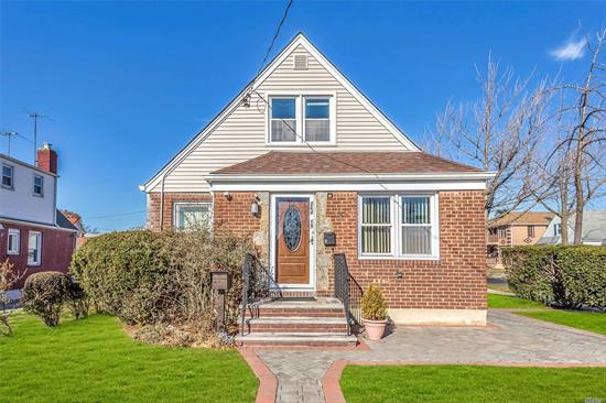 A Magnificent Corner Property At The Border Of Glen Oaks And Floral Park. Brick House Featuring 2 Car Garage.
