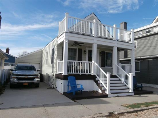 *Cape, 1 & 1/2 Stories, One Lot, 2 Bedrooms, New Full Bath, New Eat In Kitchen, New Gas Heating & Hot Water System, New Windows, Living Room, Wood Floors, New Front Porch, Full Attic With Two Bedrooms, Full Basement, 1 Lg Garage + 2 Car Driveway, Rear Patio, 1/2 Block To Reynolds Channel, Walk To Point Lookout Pvt. Beach, Ocean & Shops. *Lowest Priced Beach Home In Town* *More Photos Coming Soon!