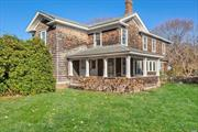 Attention Reno Professionals & Rehabbers! Circa 1900 Cedar North Fork farmhouse on coveted Peconic Lane, home to statuesque antique estates. Hardwood w/gracious common rooms-library, parlor, LR, DR & sunlit side porch, kitchen/pantry & 1/2 ba. 5BR's, full bath, plus nursery. Period details & trimwork. 1/2 acre w/detached garage. Nat Gas heat, newer roof & windows. Asking price reflective of restoration costs. Excellent candidate for 203K or other reno loan products. Bringing back the Grandeur!