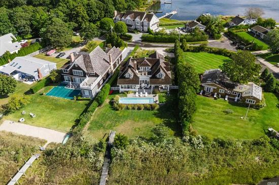 Enjoy sunset views over Sag Harbor Cove at this waterfront home with waterside pool and deep-water dock for two boats; all of this on a quiet cul-de-sac in the Redwood section of Sag Harbor Village. All rooms have a view of the water. Four ensuite bedrooms include a grand master suite on the first floor. A separate guest suite has its own entrance. Entertain and dine on your expansive waterside patio; relax in the 40 foot pool. One mile to the Village and a 15 minute drive to the ocean.