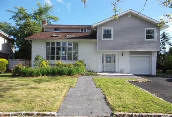 Beautiful Split Style Home Completely Renovated. Porcelain Floors, Granite Counter-tops, Stainless Steel Appliances, and High-End Bathrooms w/Custom Vanities. This Natural Light Beauty Boasts Master Suite & Three Large Bedrooms. First Floor has beautiful Foyer, Cozy Vaulted Living Room With Fireplace, and Full Bathroom. Open Floor Plan With Large Eik and Formal Dining Room. Spacious Yard with Deck-Perfect for Entertaining! Private Driveway and Garage Parking on site. Tax Grievance 2020.