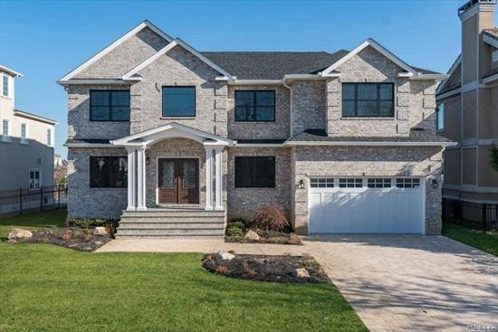 If you're looking for grand scale perfection, this home is for you!! Stunning New Construction Waterfront Colonial! Enjoy waterfront living in the heart of S. Merrick! 5/6 Bedroom, 3 full baths, Huge Master Suite with private balcony overlooking a wide canal with views of the bay. Custom Kitchen w/stunning Quartzite counters, 6 burner Wolf Range, Oven, Microwave, 6ft Sub-Zero Refrigerator, Bosch Dishwasher, Central Air, Central Vac, Flood insurance is ONLY $606/yr. Won't Last....$1, 499, 990