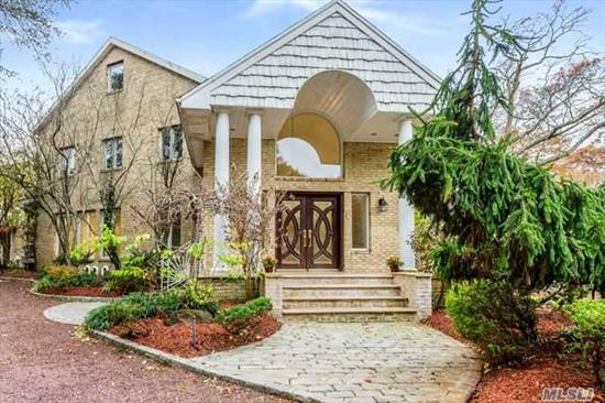 stately all brick 3 story 6 bdrm col. with grand marble foyer, chefs eik with s.s. appliances , banquet fdnrm , lg flrm, beautiful den, master bdrm suite with 2 huge walk in closets and lux bth+5 bdrms , additional guest house with 4 bdrms,  kit and 1.5 bths, ingp all on beautiful shy 1 acre property