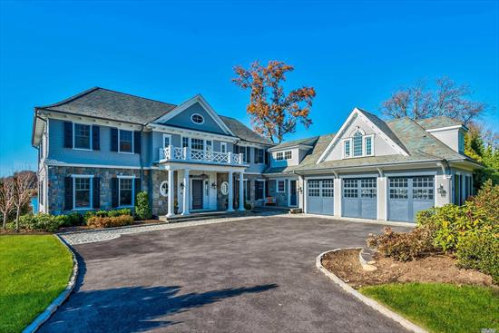 Newly Designed and Built This Connecticut Stone and Shiplap Center Hall Colonial with a Dock is Situated on a Private Road in Plandome Overlooking Manhasset Bay. Offering 7 Bedrooms, 6 Full Baths, 3 Half Baths, School District #6.