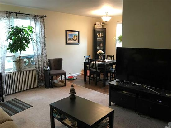 Lovely Sun Filled Second Floor Unit Offers One Bedroom, Living Room, Dining Area, Updated Kitchen, New Bath, Near Public Transportation, Plenty Of Street Parking Available