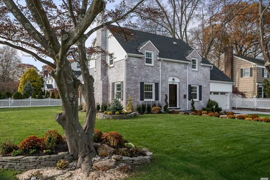 Luxurious & completely renovated Georgian styled Colonial. EVERYTHING NEW! Plumbing, Electric, Heating System, Central A/C, Roof, Siding, windows, Floors & all fixtures. Stunning landscape design & Sleek new pavers , back porch with exquisitely stained cedar ceilings and and elegant chandelier. Timeless new kitchen cabinetry complimented with champagne bronze hardware and fixtures. Master Suite w/cathedral ceilings, WIC, Elegant Marble master bath, gorgeous 2nd fl bath w/ whirlpool jets.
