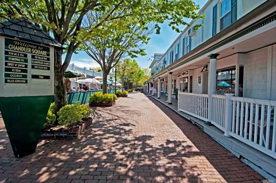 Unit above Retail Stores @ Chandler Square in the Heart of Port Jefferson Village on the corner of Main Street and West Broadway- Second Floor Walk - Entry from Interior Courtyard next to Snow White Ice Cream Store- Unit is first Unit on the left overlooking the Brewery.