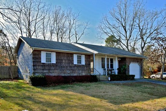 Manor Village North Mastic Area. Charming Ranch style Home, LOW TAXES, quite setting on a dead end Street, easy access to major roads.CORNER PROPERTY, 3 BEDROOMS, 2 FULL BATHS, FULL BASEMENT HALF FINISHED, FENCED IN HUGE BACKYARD. ATTACHED GARAGE. Make this home your own.!