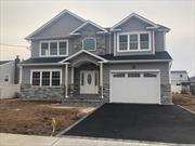 Stunning 4 Bedroom 3 Full Bath New Construction Colonial! Quality Build! Spacious Open Floor Plan,  Huge Kitchen w/Island, and Stainless Steel Appliances, Wood Floors Throughout, Den W.Fireplace, 9 Foot Ceilings On 1st Fl, 8Ft Ceilings On 2nd Fl & Basement! Laundry Hookup On 2nd Fl. Energy Star Efficient Home!