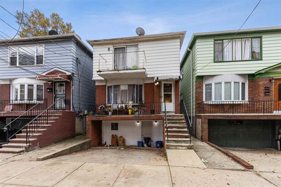 OPEN HOUSE 12/7 & 12/8 from 1-3PM. PRIME LOCATION! A true gem, situated on the border of Journal Square and downtown Jersey City, near the desirable section of Hamilton Park. With just a 5 minute walk to Journal Square Path offering only a 10 minute commute to NYC!Nestled on a 25x125 lot including 3065 Sq Ft. This legal 2-family home has so much to offer. Original hardwood floors, move in ready and in need of cosmetic upgrades. Driveway can fit 2 cars with the option of having the garage accommodate an additional two spaces for a total of 4 car spots. Unit 1, currently a duplex, has a total of 5 bedrooms and 2 full baths with an open floor layout. The kitchen opens up to a large dining and living area and is great for entertainment. Ground level also offers two private entrances, 3 bedrooms, 1 full bath and the option of adding an additional kitchen/living room area. Unit 2 offers 3 bedrooms, 1 full bath and a large kitchen/dining area as well. Large oversized backyard. Recently upgraded electric panel. Located near all major transportation, houses of worship, major highways including 78, NJ turnpike and RT 139. Only a 5-10 Minute drive through Holland Tunnel into NYC. Private grammar school at the end of the block and high school only 2 blocks away. Located near all major shops, restaurants and parks, this home is a must see! Amazing investment opportunity or occupying with great rental income. Sold As Is