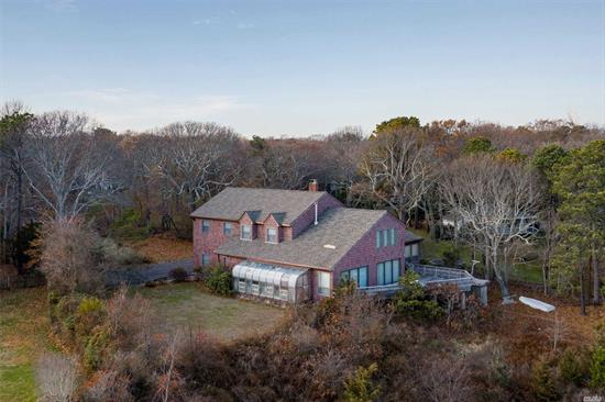 Nearly 1.4 Acres on Shinnecock Bay, Directly across from Shinnecock Inlet. 4000 square foot house with panoramic bay views. Basement floor is 19' above median high tide!