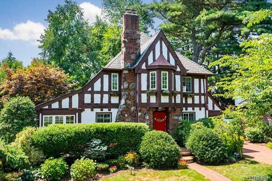 Stunning, unique and partially furnished, this tudor-style home sits on a park-like corner lot in the heart of Merrick! Located south of sunrise highway, this stately home features 3 bedrooms, A BRAND NEW FULL BATHROOM, a main floor powder room,  an updated kitchen, a large master w/ sitting area, beautiful decor, a sun/garden room, family room, formal living and dining areas, as well as a backyard made for entertaining with a patio, lounge area and chef's BBQ,
