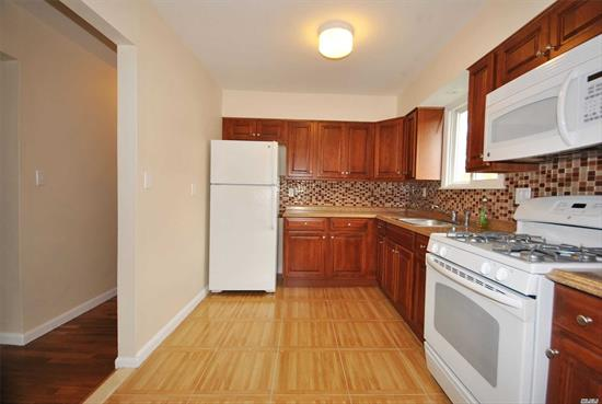 Totally Modernized, 3 Bedroom, 1 Bath Apartment. Living Room, Dining Area, Spacious Kitchen. Beautiful Wood Floors, W/D In Apartment, Near Pool And Tennis Courts. 2nd Floor, Private Entrance. 2 off street parking spaces. No pets allowed.