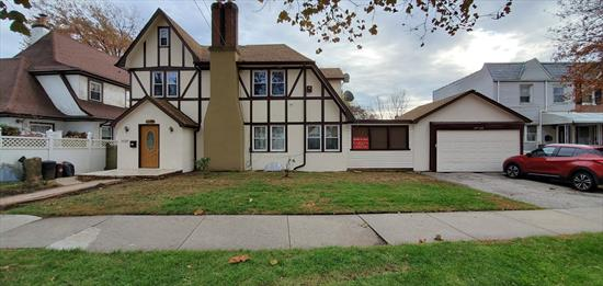 Charming Tutor Style Home on Tree Lined Block in the Heart of Flushing. The Main Level of This Lovely Home Features 1 Bedroom, A Large Living Room with Fireplace, A Formal Dining Room, A  Very Spacious Eat In Kitchen with Stainless Steel Appliances and A Bonus Room for An Office. The Second Level Features 3 Large Bedrooms and 1 Full Bathroom. The Third Level Features a Stand Up Attic with a Half Bath. This Home Also Boasts a Large Full Basement As Well As a Separate Garage For Additional Storage Space.