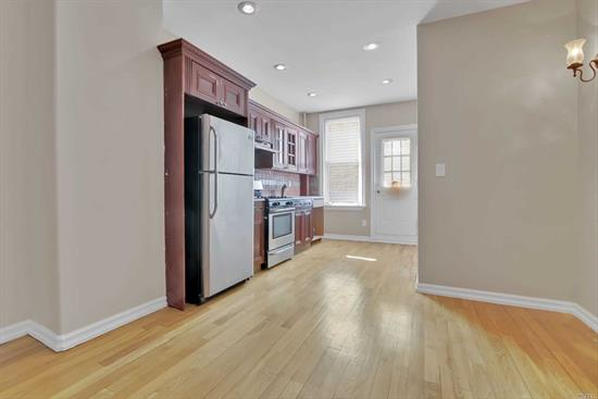 Beautiful & Bright One Bedroom with a bonus room and closets in both! Big Open concept Kitchen/Living Room combo with a cozy breakfast/dining nook. Hardwood floors throughout.