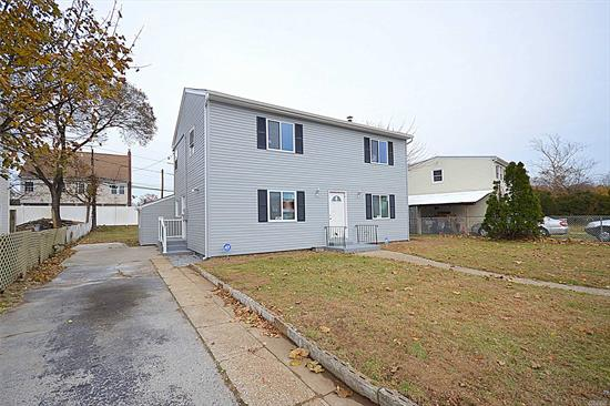This state of the art colonial is newly renovated with 4 spacious bedrooms, 2 full bathrooms, formal living room and dining room, kitchen with countertop and stainless steel appliances. Hardwood floors, plenty of closets, Full basement with high ceilings with egress windows and outside entrance. Must see!