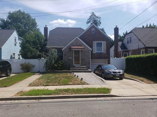 Split level Cape 3 bdrm, 1.5 bth, shower room, laundry room, fin full bsmt, EIN Kit, pvt dwy and garage, new roof/gutters, granite counter tops, new stainless steel appliances, hardwood floors and hard wired landscaping lights and plenty of closet space. Close to public transportation, shopping and places of worship. Walking distance to public schools. Must see.