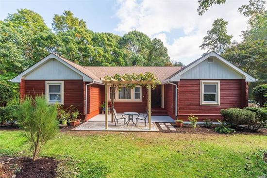Located in the beautiful Hamlet of Baiting Hollow, this charming, authentic log home is tucked away in desirable Oak Hills, a year-round Private Beach Community! Built in 1958 by two Grumman engineers, this cozy home retains many of it's original features including hardwood floors and doors, vaulted ceiling with fireplace & wood stove and an outdoor fireplace. Bonus loft, split A/C heating sys., private Trex deck, pergola, fin. basement w/ o.s.e. & egress windows. Updates to electric & plumbing.