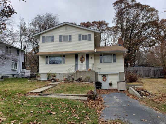 Wonderful Colonial On Quiet Tree Lined Street. Large Living Space, Hardwood floors, Updated Bathrooms, Newer Kitchen, Andersen Windows Crown Moldings, Great Finished Basement, Wood Burning Fire Place, Fenced Yard, Kings Park Schools.