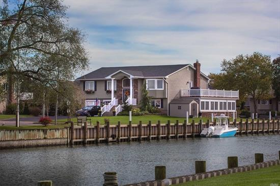 Gorgeous property tucked away on a quiet waterfront Cul de Sac. Beautifully landscaped grounds, this home presents dramatic panoramic views of canals with 350' of New Navy Bulkhead with Trex decking and 2 jet ski lifts. Spacious and Immaculate home. Amenities include: Hot tub in the screened in Sunroom, Fireplace, Gas Chimenea overlooking main canal, beautiful kitchen with cathedral ceilings, Wraparound Trex sun deck with fabulous views. Stunning Sunsets!