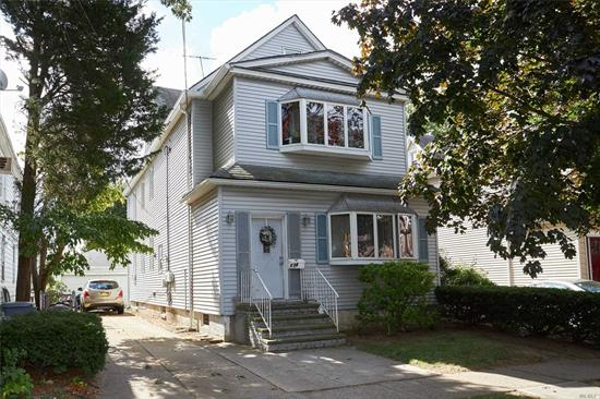 Classic 2 Family home, 2 Bedrooms on both 1st & 2nd floors. Hardwood floors. Close to all Transportation(LIRR to Penn station/Brooklyn), schools, shopping and village recreation center.