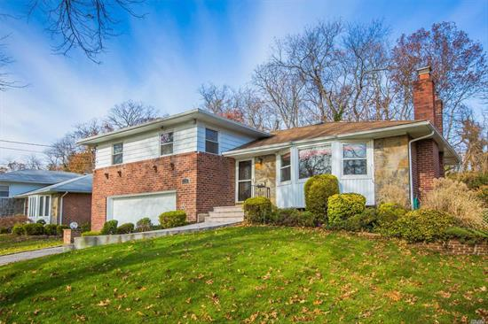 Gorgeous split four level brick home updated 5 yrs ago features three bed rooms 2.5 baths. new gas burner. new Large patio windows in family room. Attached two car garage. Herricks SD: Searingtown Elementary, Herricks Middle & High school. A block away from Starbucks, CVS & other retail shops. close to major highways.