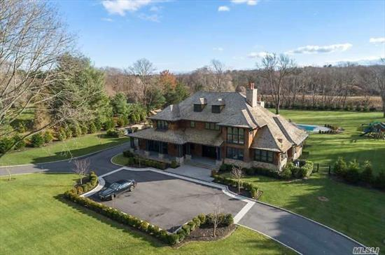 Stunning, Fully Furnished, Mojo Stumer Designed Custom Built Hampton Style Col Situated On 3 Lush Acres W/In Ground Pool+ Full Outdoor Entertainment Area. Exquisite Lr, State-Of-The-Art Kit, Bkfst Rm, Formal Dr, Laquer Panelled Den, Private Master Suite W/His+Hers Baths Complete The 1st Flr. The 2nd Flr Boasts 3 Bedrooms, 3 Baths, Den/Bedrm + A Fully Equip. Gym. The Lower Level Has A Movie Theatre, Game Rm, Guest Quarters+Bath And A Massage Rm With Lots Of Storage. Full House Generator.