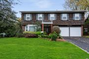 Move Right In! Unique Open-Layout Splanch, with 5 large Bdrms and 3.5 Baths. This over-sized corner property on a desirable cul-de-sac sits on the border of Old Woodmere and Hewlett. Hardwood Floors, Updated Kitchen Counters/SS Appliances, CAC, Gas Burner/Hot Water Heater and New Roof.