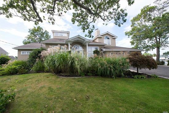 Sprawling Contemporary Water Front Home With Open Floor Plan. High Ceilings, Hardwood Floors & Home Office. Two Master Suites & A Windows Peak. Enjoy Magnificent Sunsets On A Large Deck For Entertaining.