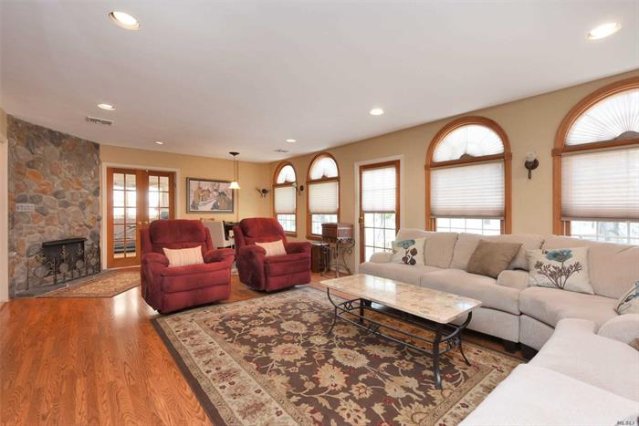 Spacious 4 BR, 4.5 Bth Colonial on 1/4 Acre Parklike Property w/ 1/2 Ct Basketball. Living Rm w/ Fpl, FDR, Family Rm, Office, EIK w/ Granite Counters & Stainless Steel Appliances. Master Ste Boasts Hi Ceiling, Bath w/ Jacuzzi, & Fpl. 4 Bedrooms on One Level. Fin Bsmt. 2.5 Car Att Garage. Beautiful Tree Lined Street in SD#14.(Hewlett-Woodmere)No Sandy Damage or Flood Insurance Required