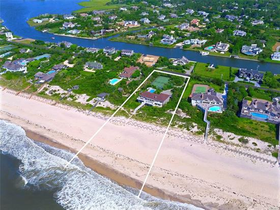 Magnificent oceanfront estate set on 2 beautiful acres in Quogue. This stunning, traditional 2-story home boasts 164' feet of ocean frontage and is well-equipped with a 2-car garage, heated gunite pool, all-weather tennis court, outdoor shower, and cabana kitchen for outside entertainment. With over 7, 000 square feet, this luxurious home features 6 bedrooms, 6.5 baths, granite kitchen countertops, living room, den, and office, complete with wood floors. Additional amenities include a fireplace