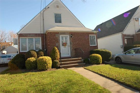 Nice Size 1452 Sq Ft Living Space! Finished Basement, 100 AMP Service, Newer Heating Furnace, Hardwood Floors Throughout! Attached Sun Room! Mrs. Clean Lives Here! All Pella Windows. Walk to L.I.R.R. and Bus. Walk to Schools, & shopping.