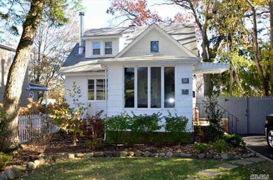 Cozy Cape Cod! Ef, Living Rm w/Vermont Cast Wood Burning Stove, Eik, Fdr, Full Bath & Half Bath. 2nd Floor; Master w/Full Bath, Addl Bdrm. Full Finished Basement w/Den, Laundry, Utilities & OSE. Generator, Updated Electric 150amp, Updated Plumbing Copper Throughout. Fenced in Yard w/Deck. 1 Car Detached Garage. Minutes form Train, Shopping and Beach. Award Winning North Shore Schools!