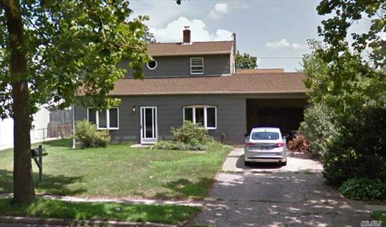 This is a 3 bedroom, 1 full bath Levitt Cape with Dormer. Needs some TLC.