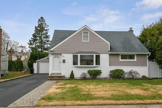 Who Is Ready To Move Into This Rear Dormered 4 Bedroom, 2 Bathroom Cape? Newly Painted, Refinished Hard Wood Floors, New Roof, Newer Siding, Updated Boiler & New Oil Tank. The Kitchen Includes Updated Appliances & Gas Propane Cooking. Professionally Landscaped Including, Driveway & New Fenced In Yard.