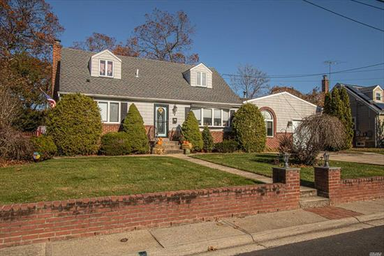 Super Expanded cape in the very desirable Poet section of North Babylon. 5 large Bedrooms, Updated Kitchen with all new stainless appliances w/ gas stove , Updated Baths, Hardwood floors, gas fireplace, full finished basement, new roof, slim unit A/C. THIS WON'T LAST !!!