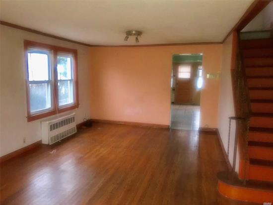 Beautiful Colonial Home in Elmont NY. Livingroom, spacious kitchen and Half a bath on the first floor. Generous basement, 2 large bedrooms and a full bathroom on the second floor. Private Garage and driveway with big backyard.