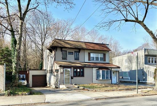 large property with plenty of parking space with one attached garage. spacious backyard with storage shed. many updates including kitchen and bath Open kitchen has large eat-in granite island top. Plenty of sunlight gas heat and gas cooking. hardwood floor throughout. convenient location next to Northern Blvd. Near shopping and transportation. walking distance to LIRR Little Neck Great opportunity!